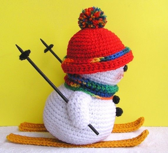 **PLEASE NOTE THAT THIS IS A PATTERN ONLY - NOT THE FINISHED SNOWMAN** It is still warm where I live but I had a vision just pop into my head of a little snowman skiing and I had to design him. So here he is. He stands about 9 1/2 tall and his skiis are 10 long. He is done almost all in single crochet except for the trim on his hat, his scarf and his skiis which are done in half double crochet. He was designed and made all in one afternoon, so he is a fast and easy pattern. If you have ...
