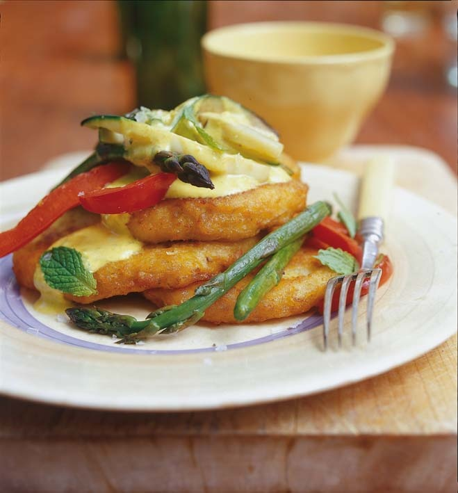 Crisp vegetables on chickpea and potato cakes with a lightly curried sauce