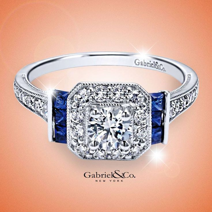 A hint of blue for a love that always stays true. Gabriel & Co. white gold diamond halo engagement ring with sapphire accent stones.