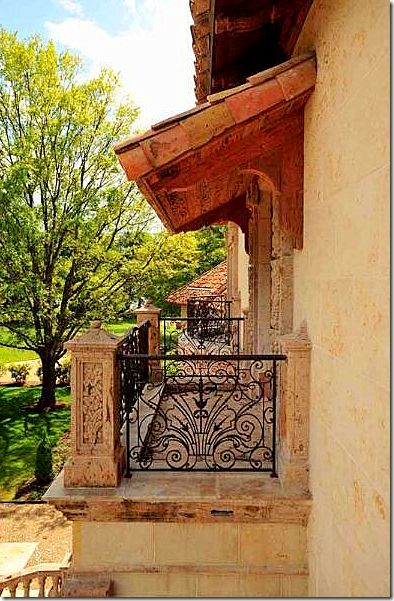 Tuscany style balcony.  Solid stone materials and wrought iron.  Important elements used here.  This is what gives it that authentic Tuscany style charm we look for.
