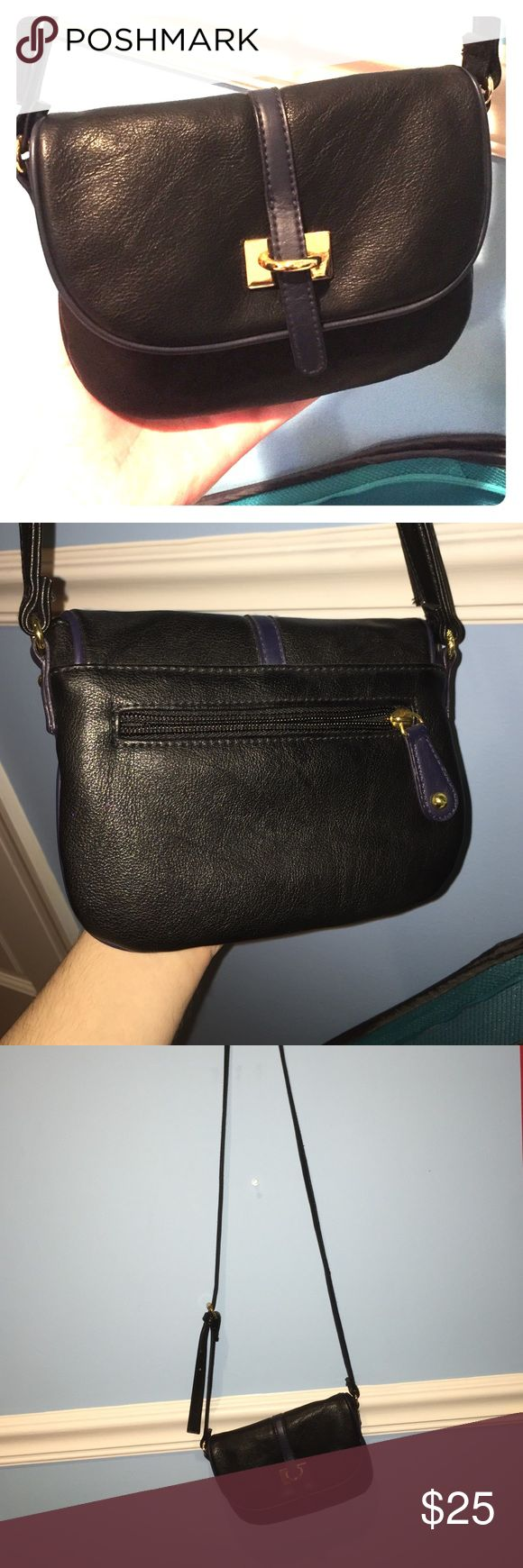 XXI black and navy purse with strap Like-new XXI brand purse with long, adjustable strap, inner and outer pockets. Main body and strap are black faux leather with navy faux leather accent strip. Gold buckles and snap. Barely used. XXI Bags Crossbody Bags