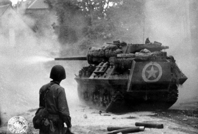 American M10 Wolverine tank destroyer firing near Saint-Lô France Jul 1944
