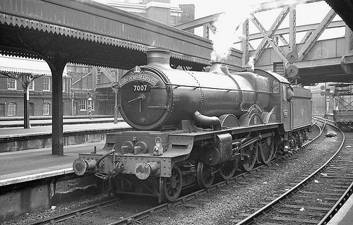 GW Castle 7007 'Great Western' has arrived with an express from Worcester and is now ready to be turned and serviced before returning westward. Paddington, UK. Negative scan.