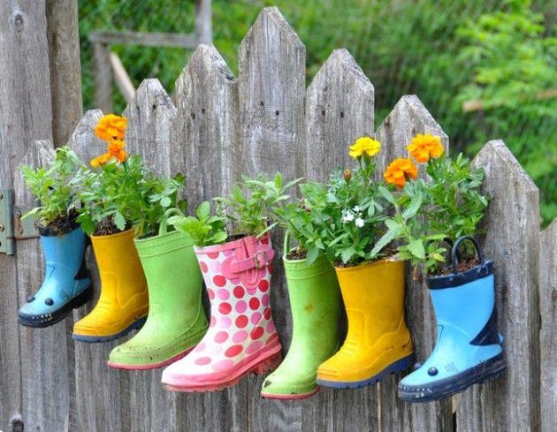 5 Ways to Make Plant Container Garden Art! - This one old colorful boots!