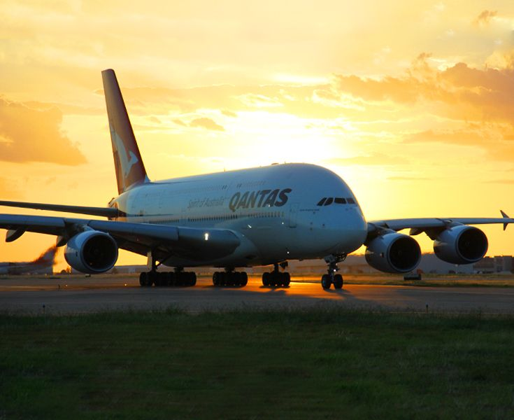 Qantas (A380) landing just in time for the sunset. - Terminal D | D6-D16