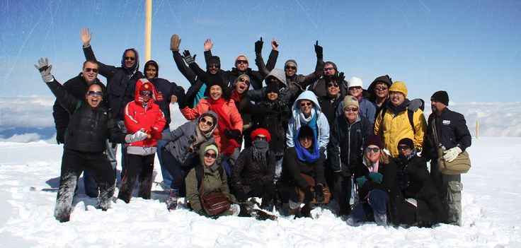 A crowd of happy travellers at Jungfrau, the Top of Europe! http://expatexplore.com/multitour_pages/europe-multicountry/