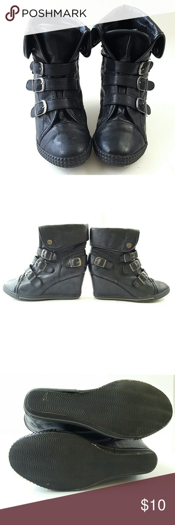 Black Wedge Ankle Boots Bucco, black wedge, ankle boots, buckle straps, all man made material, trim on the bottom coming apart (as pictured), fair condition, size 6 1/2. Bucco Shoes Wedges