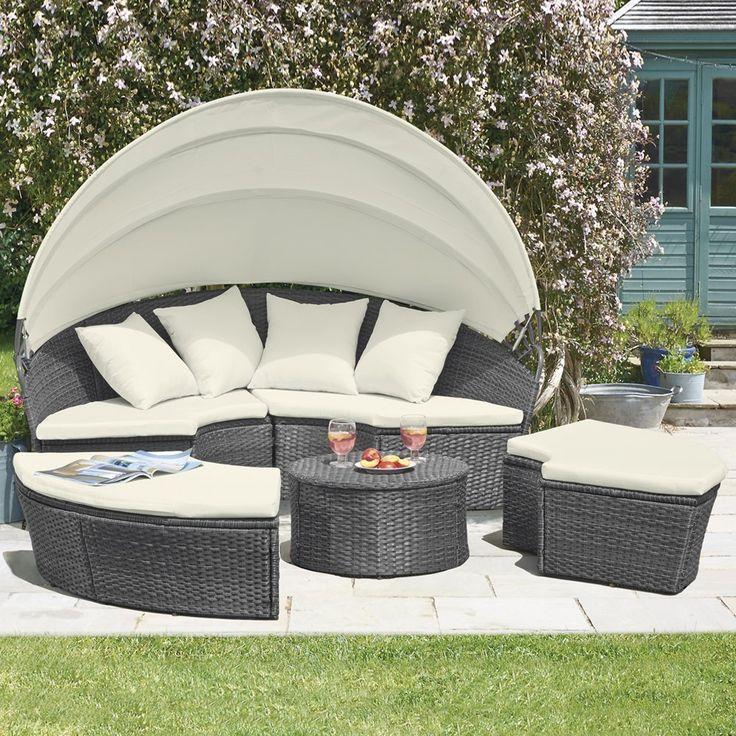 rattan garden day bed folding canopy garden sofa with cream cushions outdoor seat lounger
