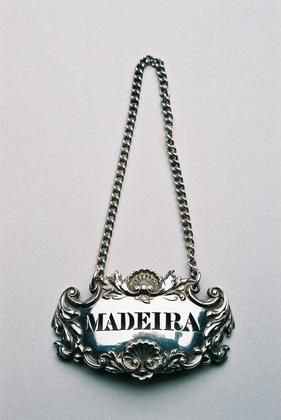 Oval label, pierced Madeira, moulded with scallop shells and scrolling foliage. Very clear hallmarks.