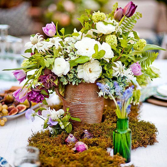 Create a sumptuous centerpiece with airy ferns and soft