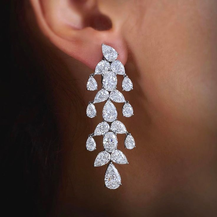 Take her breath away with the romantic and feminine Eden Chandelier Diamond Earrings. #WilliamGoldberg