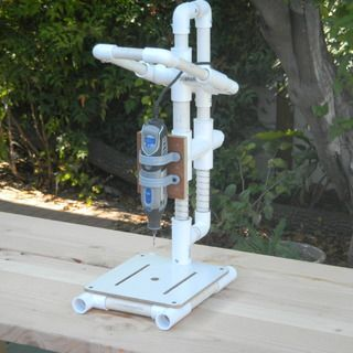 Make a PVC Dremel drill press from Instructables... good for occasional use like a special project.: