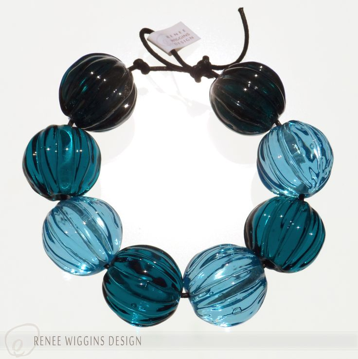 """Transparent teal tones """"seed pods""""......5/8"""" walnut shaped lamwporked beads. Organic, tribal, simply elegant. RWD 4/2015"""