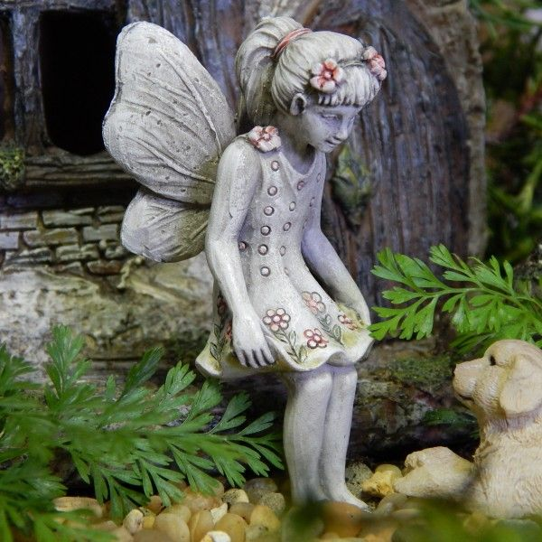 FAIRY ALLIE - Allie is a truly beautiful little fairy. She will sit and watch over your fairy garden and fairy friends. Her headband with gorgeous flowers to match her stunning dress will have the fairy garden enthusiasts squealing with amazement. Your fairy garden and it's enchanting friends will adore this beautiful little miss. #fairygardeningaustralia