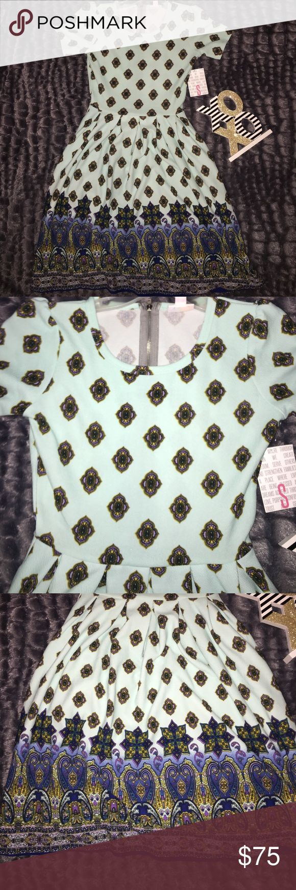 Lularoe Amelia dipped unicorn print This gorgeous Lularoe Amelia is size small new with tags. Dipped unicorn print, with mint blue/green background and elegant dipped pattern at the bottom. Zip up from the back. LuLaRoe Dresses