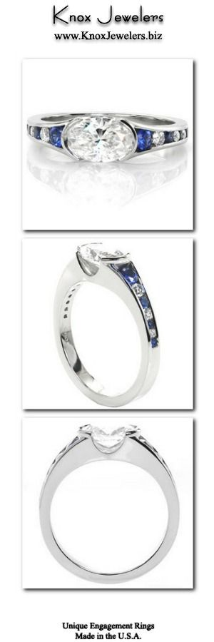 This classic engagement ring is a contemporary setting showcasing a brilliant horizontal set 1.00 carat oval diamond shouldered on either side by a half bezel. The flared band features channel set blue sapphires and diamonds, placed every-other to create an eye catching pattern. This design can be made for any type, shape, or size center stone.