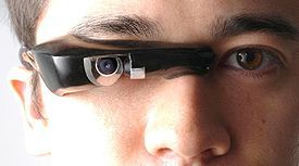 "The EyeTap is a Head Up Display combined with a Camera - essentially, a cyborg eye that projects new information in our own field of view. It was invented by a man who's underrated and ahead of his time - Steven Mann, a pioneer in Cyborg Technology and research.  Google copied, improved on the concept and ""socialized"" it with ""Google Goggles"" and soon ""Google Glass"": http://en.wikipedia.org/wiki/Project_Glass"