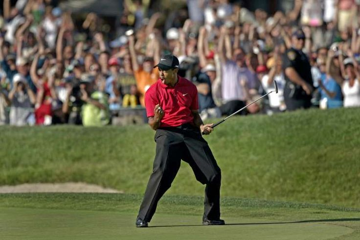 """TIGER FIST PUMP  -    Everything Woods did became iconic. His fist-pumping after a holing an important putt became famous among fans as the """"Tiger Fist Pump."""""""