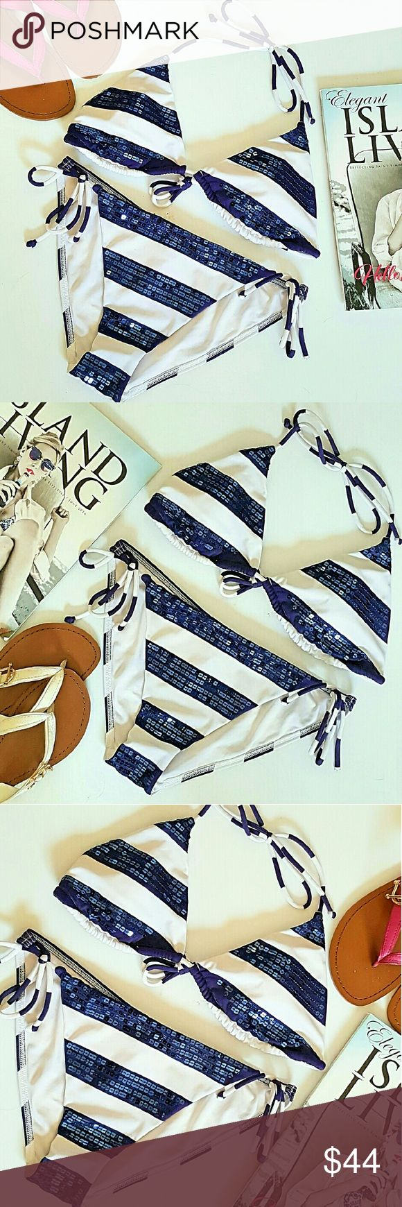 VICTORIA'S SECRET MEDIUM NAVY BLUE SEQUIN BIKINI EUC VICTORIA'S SECRET NAVY BLUE AND WHITE SEQUINED TRIANGLE STRING BIKINI. TOP AND BOTTOM ARE BOTH SIZE MEDIUM. FULL BACK COVERAGE BOTTOMS THAT TIE AT EACH HIP. REMOVABLE PADDED INSERTS ON TRIANGLE BIKINI TOP. TIES AROUND NECK AND TIES IN THE MIDDLE OF BACK. DISCOUNTED BUNDLES AND FREE GIFT WITH EVERY PURCHASE! Victoria's Secret Swim Bikinis