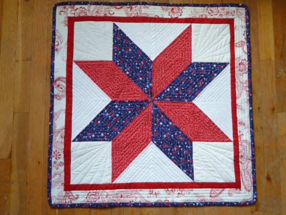 Celebrate America this summer with a beautiful red, white, and blue quilted star table runner.