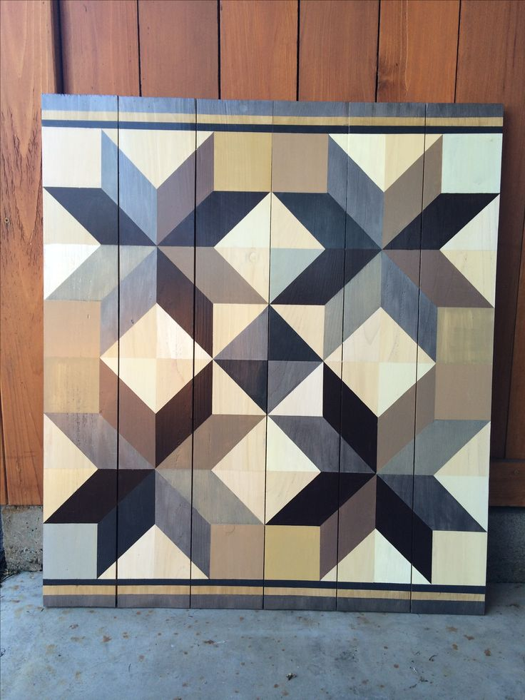 Barn quilt painted on cedar fence boards
