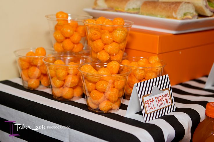 Cup full of cheeseballs serve as FREE THROWS for a basketball themed party