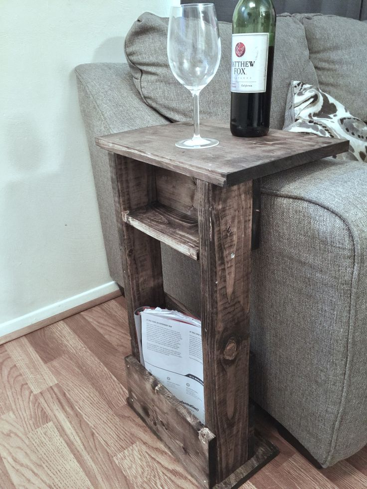 Handcrafted tray table stand with storage pocket It has been sanded down, then stained and sealed with a dark walnut finish Wood sofa arm table provide a sturdy surface for resting drinks, food, snack
