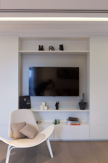 Bespoke TV alcove: Hartmann Designs created this luxury, two bedroom London duplex penthouse for a property development company