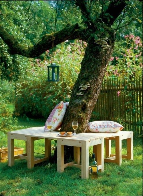 I love this natural and beautiful seating around a tree - perfection