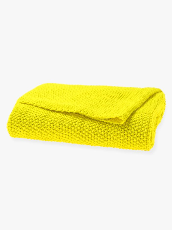 Moss stitch throw in bright yellow by Aura home, available at Forty Winks.