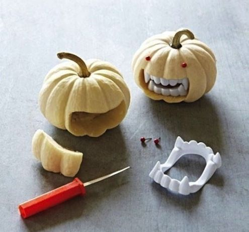 Little monstrous pumpkins! I like these and the golden thumbtack plated pumpkin because it looks like it has scales. (52 Pumpkin Decorating Ideas)