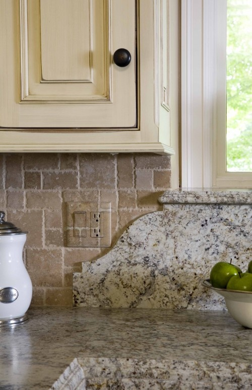 granite Backsplash curved detail and windowsill, camouflage the outlet on the tile backsplash