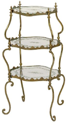 MARIA FELIX- A THREE-TIERED GILT-METAL AND GLASS TABLE,  20TH CENTURY  30 in. (76.2 cm.) high, 15 in. (38.1 cm.) long, 10½ in. (26.7 cm.) deep