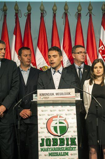 Chairman of the radical nationalist Jobbik party Gabor Vona, center, delivers his speech after the parliamentary elections in the Budapest Congress Centre in Budapest, Hungary, late Sunday, April 6, 2014. (AP Photo/MTI, Janos Marjai) ▼7Apr2014AP|Softer image helps far-right's gains in Hungary http://bigstory.ap.org/article/softer-image-helps-far-rights-gains-hungary #Jobbik_party #Gabor_Vona #Budapest