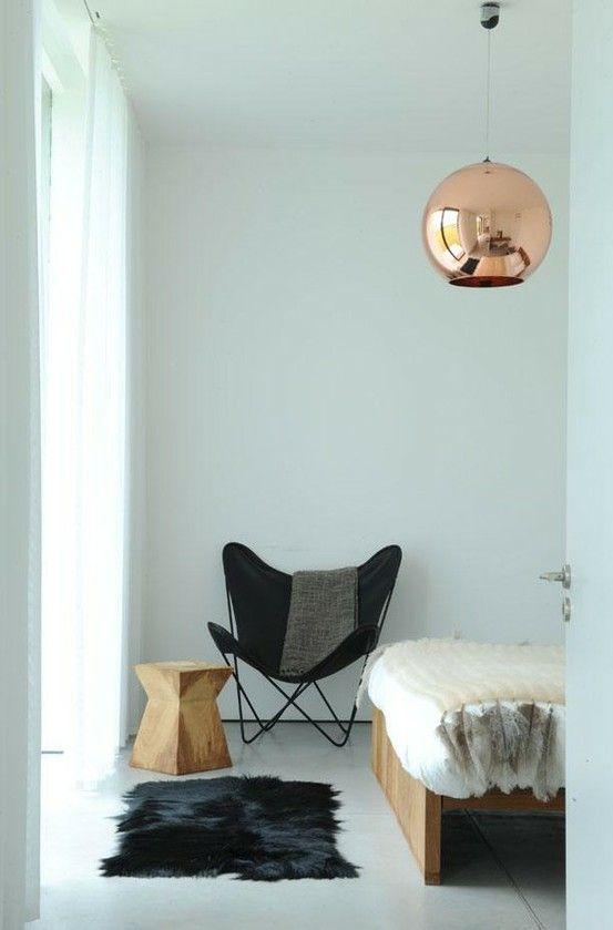 copper ball light + white wood floors + butterfly chair + fur