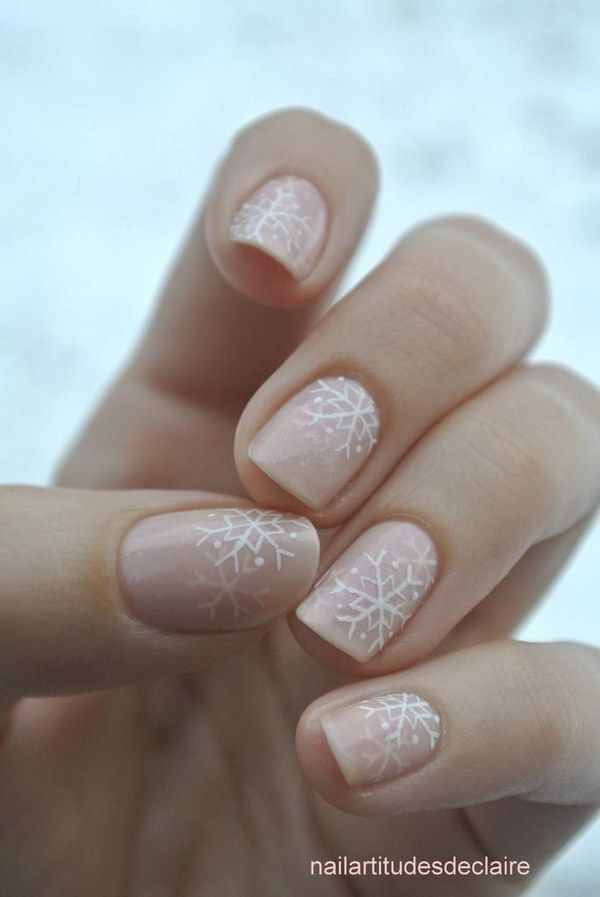White Snowflakes on Pale Pink Nails.