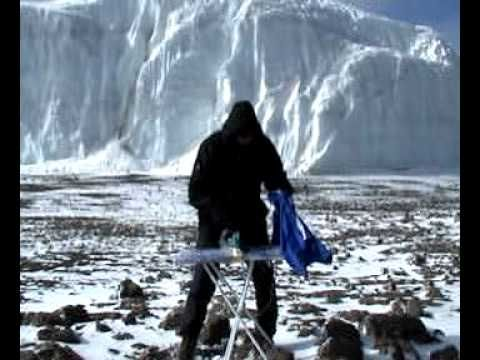 Extreme ironing by the mighty glaciers of Kilimanjaro. Can't get caught on the mountain with a creased hiking shirt. that's just not cricket