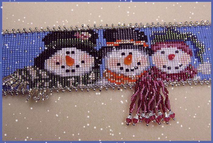 Erin Simonetti's loomed Snowmen bracelets. She teaches this pattern at Bead Soup in Savage Maryland