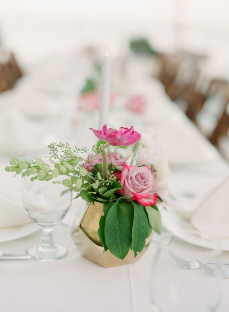 Pink Garden Rose and Ranunculus Centerpiece Accented with Greeneryhttps://www.thecelebrationsociety.com/weddings/trendy-stylish-gold-pink-wedding-villa-de-suenos-st-simons-island-ga/
