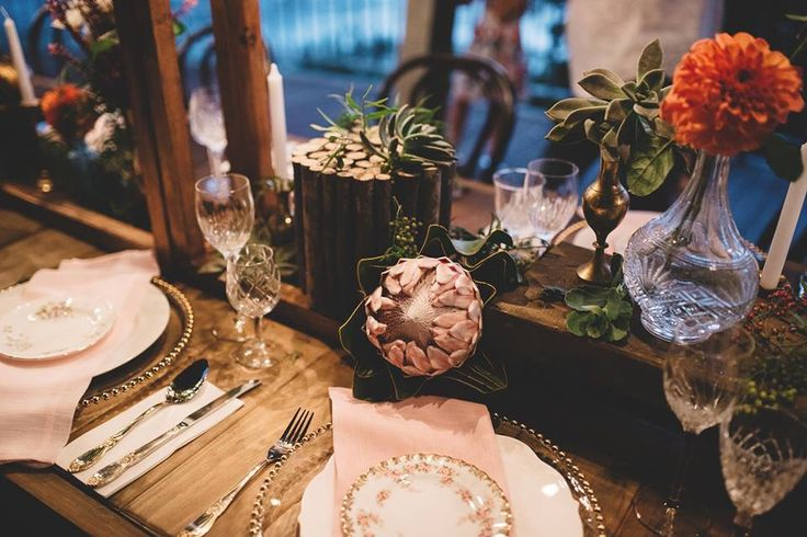 Brass + Crystal accents filled with perfectly placed blooms... Gold beaded charger plates + bentwoods are always a winning combo, not to mention that Protea    .::BorrowMyBits::.  www.borrowmybitsdecorhire.com