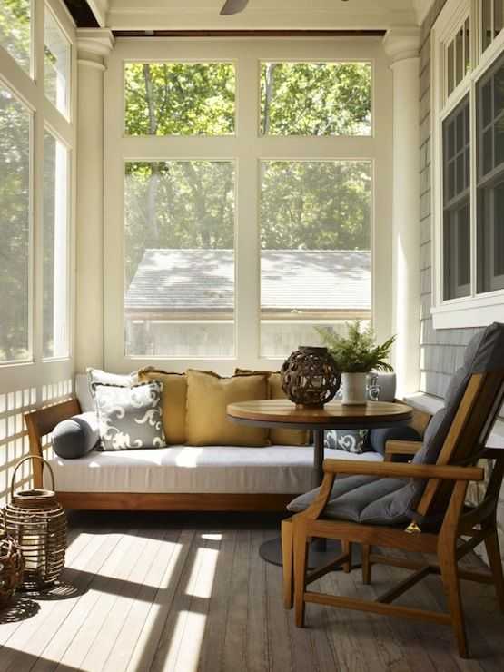 back porch covered screened patio with teak sofa yellow pillows and lanterns - Sunroom Decor
