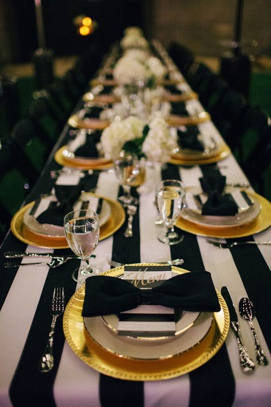 Create an elegant night time soiree with black and white patterns and gold accents.