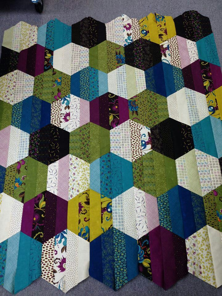 I don't love hexagons, but this stripey hexagon WIP might just change my mind! (Anyone know the artist/source?)