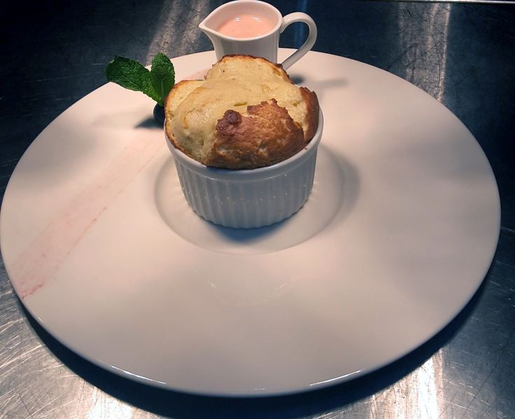 White chocolate and pistachio souffles with a strawberry cream