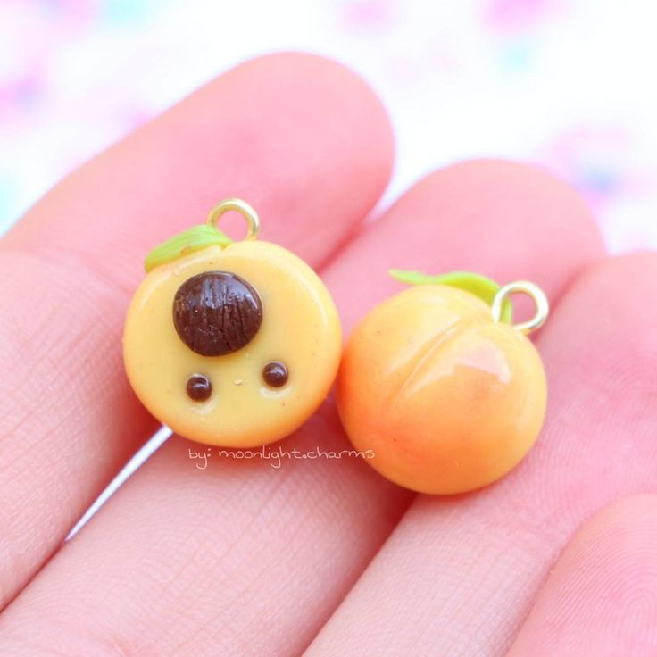 Hello everyone! Today I have more fruit! Here are two little peach charms I made a little while ago. I posted them on my story and I got a lot of amazing responses, thank you all so much! These will be listed in my next shop update which will hopefully be really soon. I'll tell you guys the date as soon as possible (probably around oct. 1st though). I still have halloween charms to finish up though, I'll get them done asap! Anyways thank you all for such nice comments on my last post even…