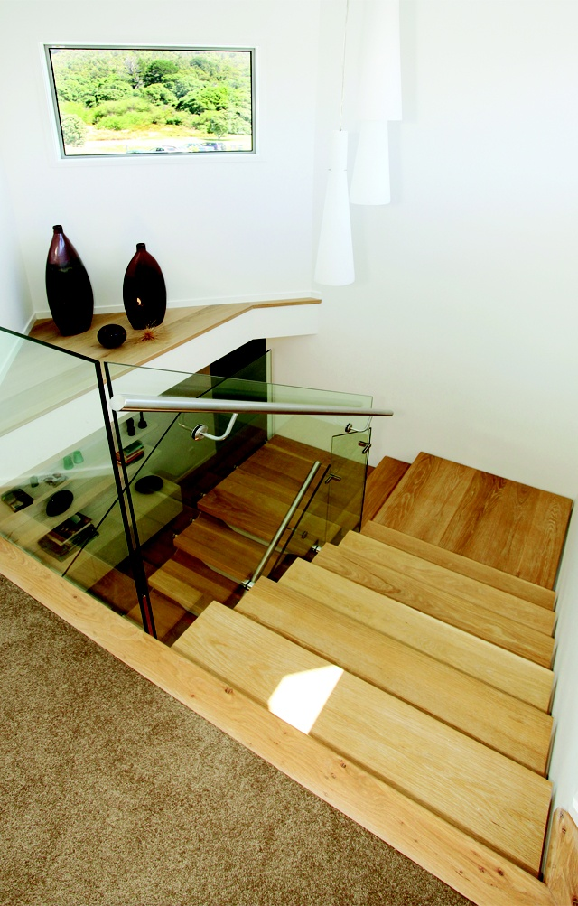 The floating staircase connects the second and third level of this beautifully renovated holiday home.