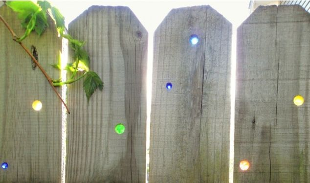 How to bring new life to a shabby privacy fence with marbles and sunshine
