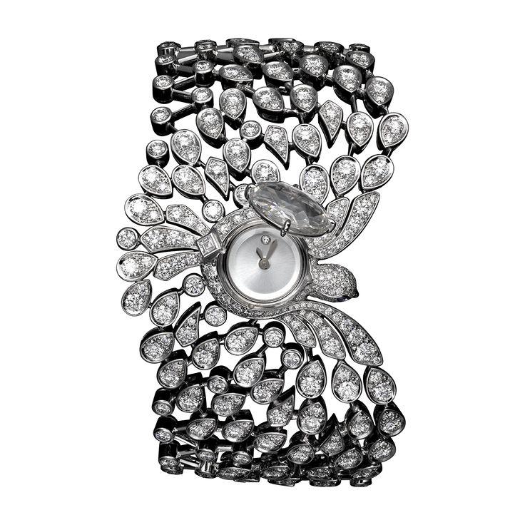 SECRET WATCH  White gold, one 2.89-carat diamond, brilliants, sapphire eyes, quartz movement.