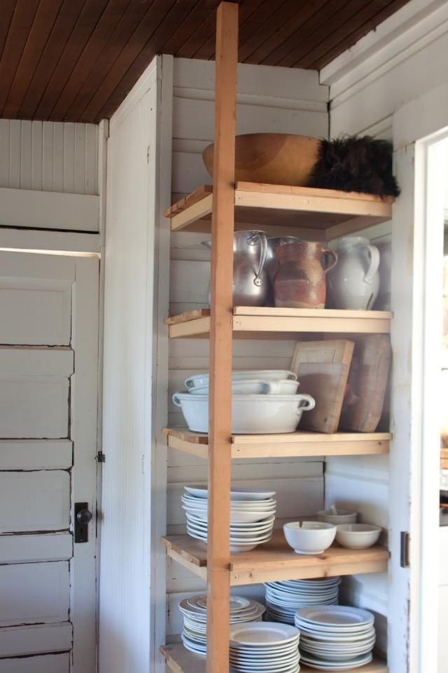 a great way to have a) open shelving, b) use a small space) and c) make dishes accessible to kiddos.