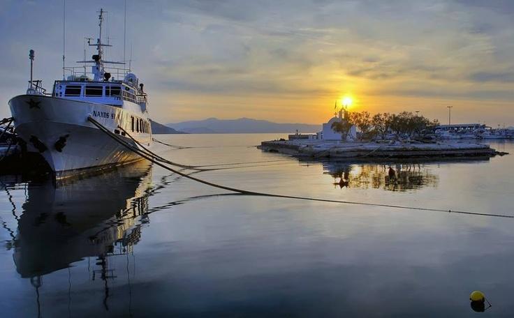 Glass-like sea in Naxos port.. Lovely infinite sunset.. Love it!